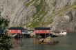 Fishing boat cruising out from Nusfjord at Lofoten