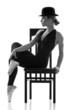 Ballet dancer girl sitting on the chair