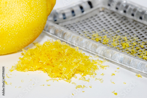 Grated lemon zest with the fruit and grater