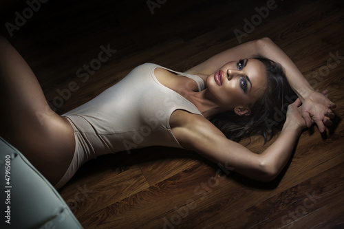 Pretty brunette in sensual position on the floor