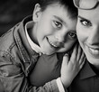 Cheerful boy hugging his proud mom
