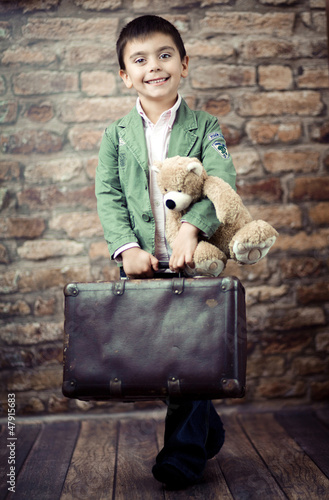 Stylish boy with suitcase
