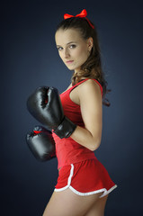 beautiful girl wearing boxing gloves