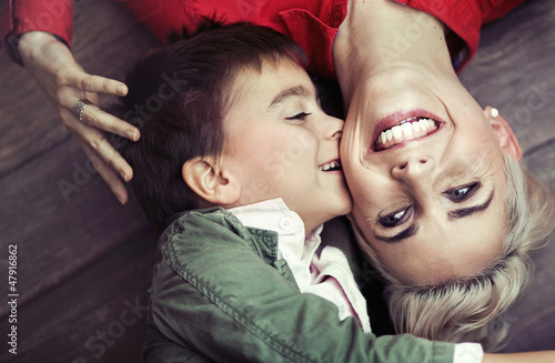 Young boy kissing his mom