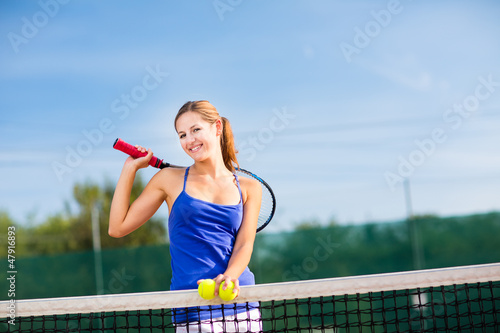 Portrait of a pretty young tennis player with copyspace