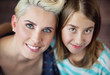 Smiling blonde woman with daughter