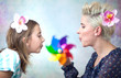 Colorful picture of playing mother and daughter