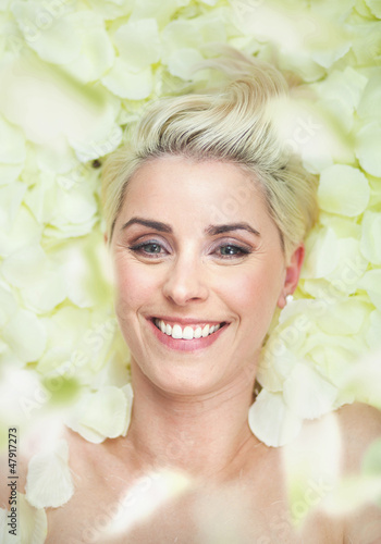 Attractive short-hair woman among white petals