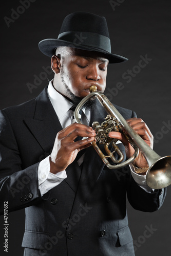 Black american jazz trumpet player. Vintage. Studio shot.