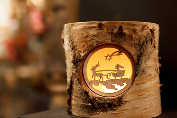 Little Santa and Reindeer scene in a birch stump