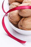 Walnuts in plate with ribbon