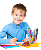funny boy is drawing with pencils