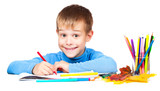 happy kid is drawing with pencils