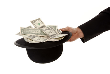 Begging with bowler hat full of dollars