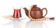 glass of Turkish tea and kettle isolated on white