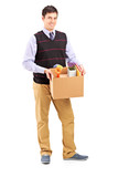 Full length portrait of a young male holding a moving box