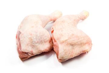 raw chicken legs on a white background.