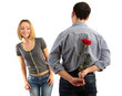 loving man holding red rose for his woman isolated on white