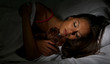 young beautiful woman with fluffy bear sleeping in bed in dark