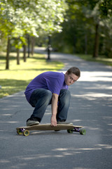 Young teenager rolling around on his longboard