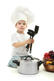 little girl doctor in chef's hat with kitchen accessories and