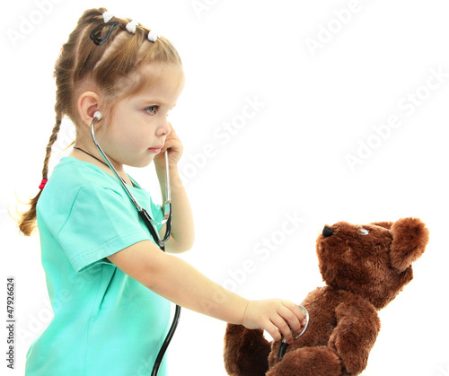 little girl doctor with toy bear, isolated on white