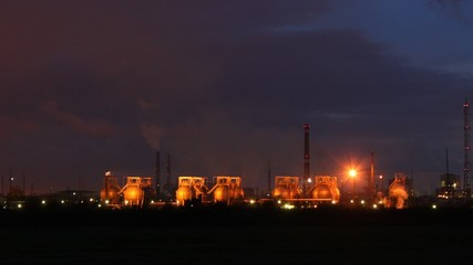 Phosphoric factory is shine by lanterns against the night sky in
