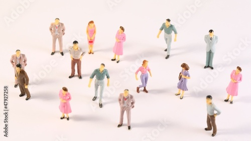 Miniatures of men and women appear on screen