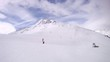 Tourists go on skis on mountain Tiefenbach downwards