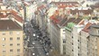 Cars and people go on Favoriten Strasse - pedestrian zone with
