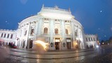 Cars go near to Burgtheater in rain