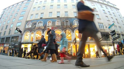 Tourists walk on central pedestrian street of Vienna - Kartner