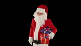 Santa Claus holding presents, against black