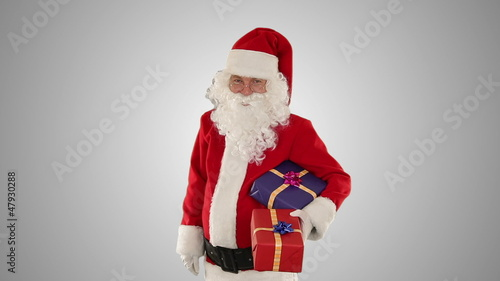Santa Claus holding presents, against white