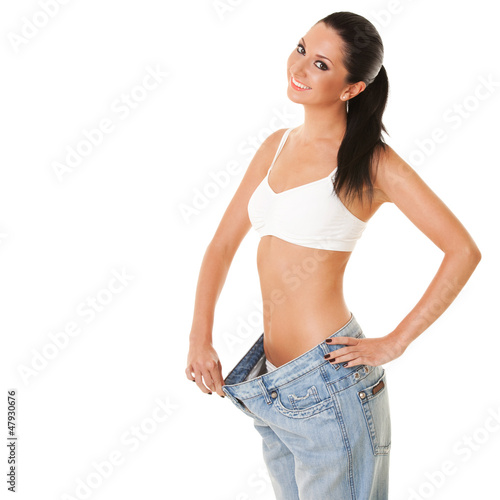 Funny woman shows her weight loss by wearing an old jeans, isola