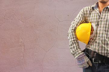 Worker and the cracked concrete vintage brick wall background