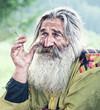 smoking old man - 47932411