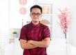 Chinese man standing indoors