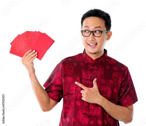 Asian man showing many red packet