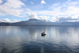 A lonely boat on Lake Maggiore ( Italy )