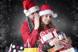 Girl whispering a secret boyfriend's ear.Happy christmas couple
