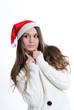 The girl in a white sweater and a Christmas cap