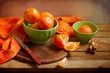 Still life with orange mandarins on wooden table