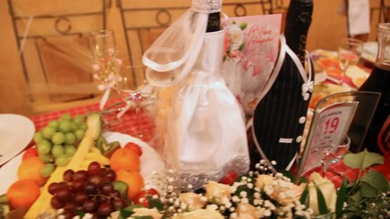 Wedding festive table with champagne fruit flowers and postcard