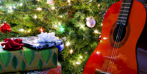 A Red Classical Guitar Under the Tree