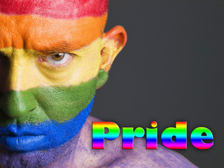 Gay flag face man, serious expression and pride concept