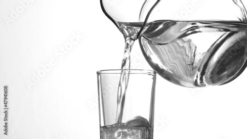 Clear water with pitcher and glass