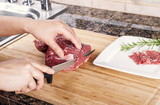 Cutting Thin Slices of Lean Red Lamb Meat