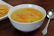 Vegetarian/Vegan Yellow Split Pea Soup  with Crackers and Spoon