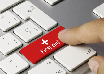 First aid keyboard key. Finger